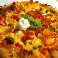 Foto tomada en Boston Pizza por Scott M. el 12/30/2011