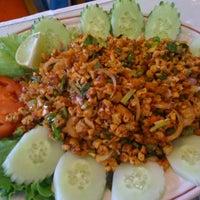 Photo taken at Esan Thai Restaurant by Donrudee S. on 8/13/2011