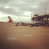 Photo taken at Gate E18 by Benedict C. on 12/6/2011