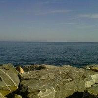 Photo taken at Spiaggia Santo Stefano Al Mare by Marianna R. on 8/16/2011