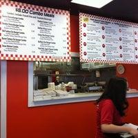 Photo taken at 25 Burgers by Kompheak T. on 2/28/2012