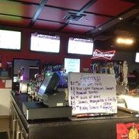 Photo taken at Rudino's Sports Corner by Mark H. on 4/20/2012