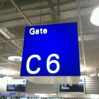 Photo taken at Gate C6 by Christoph B. on 1/7/2012