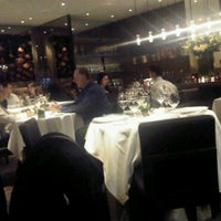 Photo taken at Lumiere Restaurant by Grace W. on 3/5/2011