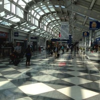 Photo taken at Concourse C by Christopher B. on 3/20/2012