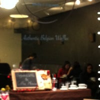 Photo taken at Michi Waffle & Espresso Bar by William C. on 1/15/2011