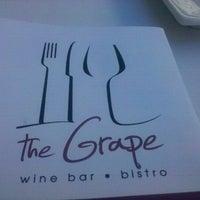 Photo taken at The Grape Wine Bar & Bistro by Douglas W. on 9/10/2011