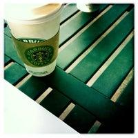 Photo taken at Starbucks by Alex N. on 1/11/2011