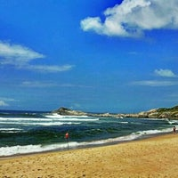 Photo taken at Praia da Ferrugem by Thiago A. on 2/23/2012