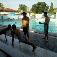 Photo taken at kolam renang Tirta Bhirawa Kopassus by Zana Z. on 11/19/2011