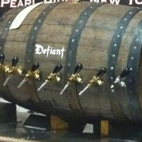 Photo taken at Defiant Brewing Co. by Louisa V. on 1/14/2012