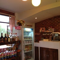 Photo taken at กาแฟใบไม้ by Jane J. on 2/17/2012