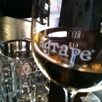 Photo taken at The Grape Wine Bar & Bistro by Katie M. on 9/23/2011