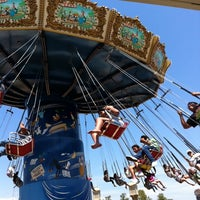 Photo taken at Silly Symphony Swings by Travis M. on 7/30/2011