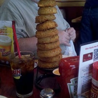 Photo taken at Red Robin Gourmet Burgers by Signe G. on 4/15/2012