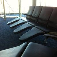 Photo taken at Gate C8 by Debra W. on 10/15/2011