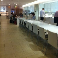Photo taken at Oneworld Business Lounge by Emily V. on 6/9/2012