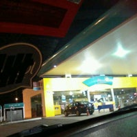 Photo taken at Petronas by Nur F. on 1/13/2012