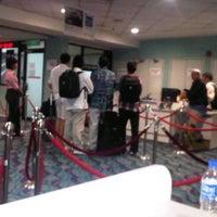 Photo taken at Gate 12 by Nylda Z. on 11/21/2011