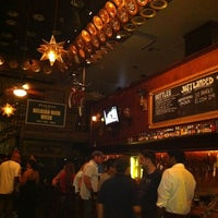 Photo taken at Flying Saucer Draught Emporium by MKT EMDF S. on 7/19/2011