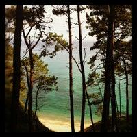 Photo taken at Playa de Oleiros by Miguel C. on 8/13/2012