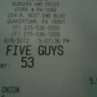 Photo taken at Five Guys by Emily M. on 6/8/2012