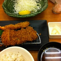 Photo taken at とんかつ新宿さぼてん デリカ大竹店 by Казуаки Х. on 7/14/2012