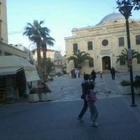 Photo taken at Saint Titos Square by Pavlos E. on 3/18/2012