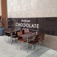 Photo taken at Theobroma Chocolate Lounge by Jamie on 7/23/2012