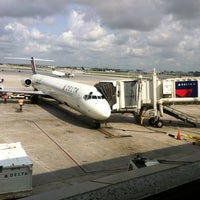 Photo taken at Gate D8 by Shawn B. on 5/14/2012