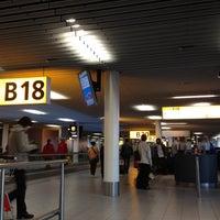Photo taken at Gate B18 by Irina N. on 3/25/2012