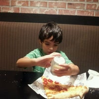 Photo taken at Flippin' Pizza by Shaun D. on 10/12/2011
