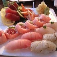 Photo taken at Sweet Ginger Asian Bistro & Sushi by Ryan on 7/22/2012