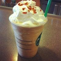 Photo taken at Starbucks by Jesi B. on 1/8/2012