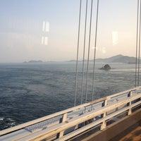 Photo taken at Onaruto Bridge by Shingo on 5/27/2012