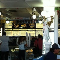 Photo taken at The Mad Greek Cafe by Ziba P. on 7/8/2012