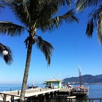 Photo taken at Praia do Perequê by Kelly D. on 7/21/2012