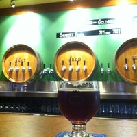 Photo taken at Cascade Brewing Barrel House by emuchico W. on 4/28/2012