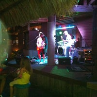 Photo taken at Sharky's Beachfront Restaurant by Andy W. on 7/7/2012
