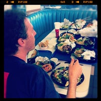 Photo taken at The Mad Greek Cafe by Ryan C. on 1/28/2012