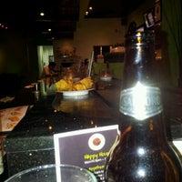 Photo taken at Sushi Eye in Motion by Juan R. on 4/10/2012