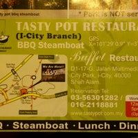 Photo taken at Tasty Pot BBQ Steamboat Buffet Restaurant by Ilya G. on 12/18/2011
