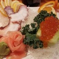 Photo taken at Tsunami Sushi by Jenn G. on 2/23/2012