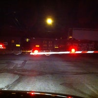 Photo taken at Michigan Street Railroad Crossing by Jay P. on 3/20/2011