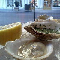 Photo taken at John Dory Oyster Bar by Julian M. on 1/9/2012