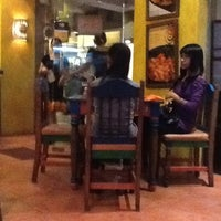 Photo taken at Mooon Cafe by Vinz on 7/22/2012