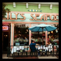 Photo taken at Lily's Seafood Grill & Brewery by Karen F. on 5/12/2012