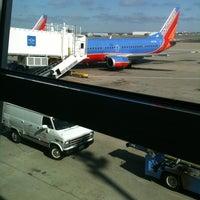 Photo taken at Gate E8 by Scott C. on 3/5/2012