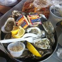 Photo taken at Hot N Juicy Crawfish by Gina T. on 5/28/2012