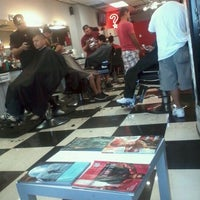Photo taken at Hall of Fame Barbershop by Briana J. on 12/31/2011